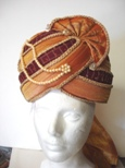orange and maroon prince hat